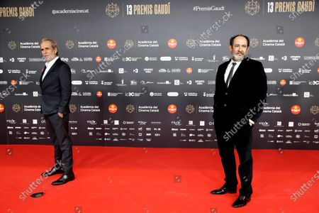 Stock Image of Karra Elejalde (R) and Willy Toledo (L) pose for the media on the red carpet of the 13th Gaudi Awards gala held in Barcelona, Catalonia, Spain, 21 March 2021.