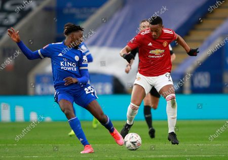 Stock Image of Manchester United's Anthony Martial, right, duels for the ball with Leicester's Wilfred Ndidi during the English FA Cup quarter final soccer match between Leicester City and Manchester United at the King Power Stadium in Leicester, England