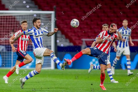 Alaves' Joselu, left, fights for the ball with Atletico Madrid's Yannick Carrasco during the Spanish La Liga soccer match between Atletico Madrid and Alaves at the Wanda Metropolitano stadium in Madrid, Spain