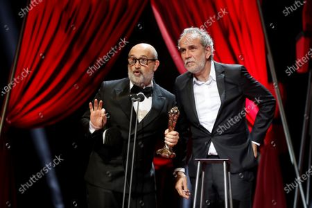 Willy Toledo (R) and Javier Camara (L) receive the Supporting Actor Gaudi Award won by Spanish actor Alberto San Juan during the 13th Gaudi Awards gala held in Barcelona, Catalonia, Spain, 21 March 2021.