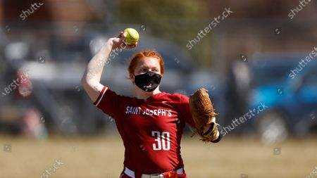 St. Joseph's Erica Lawrence throws against LaSalle during an NCAA softball game, in Philadelphia