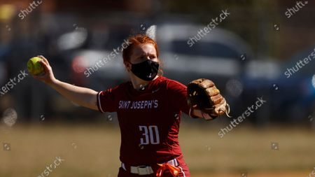 St. Joseph's Erica Lawrence makes a play against LaSalle during an NCAA softball game, in Philadelphia