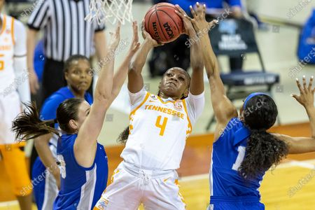 Tennessee guard Jordan Walker, center, goes to the basket between Middle Tennessee State forward Courtney Whitson and guard Anastasia Hayes during the first half of a college basketball game in the first round of the women's NCAA basketball tournament at the Frank Erwin Center in Austin, Texas