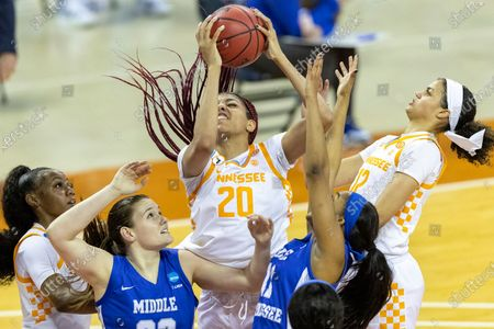 Tennessee center Tamari Key (20) pulls down a rebound with guard Jordan Walker and guard Rae Burrell, right, above Middle Tennessee State forward Courtney Whitson and guard Aislynn Hayes (11) during a college basketball game in the first round of the women's NCAA basketball tournament at the Frank Erwin Center in Austin, Texas