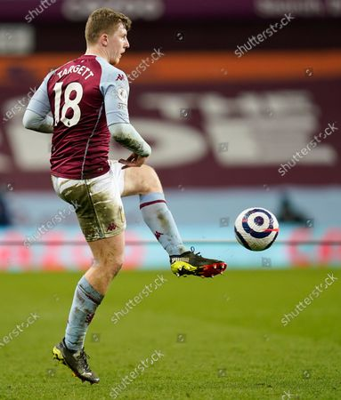 Aston Villa's Matt Targett kicks the ball during the English Premier League soccer match between Aston Villa and Tottenham Hotspur at Villa Park in Birmingham, England