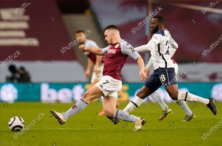 Aston Villa's John McGinn (L) in action with Aston Villa's goalkeeper Lovre Kalinic (R)  during the English Premier League soccer match between Aston Villa and Tottenham Hotspur in Birmingham, Britain, 21 March 2021.
