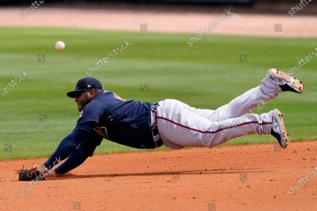 Atlanta Braves first baseman Pablo Sandoval can't reach a ball hit for a single by Tampa Bay Rays' Willy Adames in the fifth inning of a spring training baseball game, in Port Charlotte, Fla