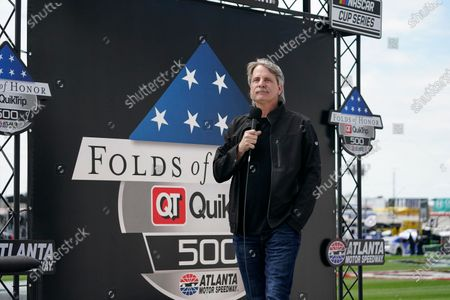 Stock Picture of Comedian Jeff Foxworthy speaks to the fans before a NASCAR Cup Series at Atlanta Motor Speedway, in Hampton, Ga