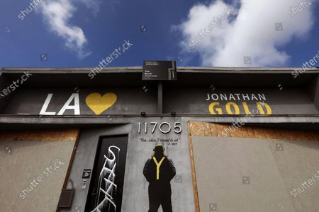 Stock Image of 11705 W Pico Blvd, Los Angeles A mural of former Los Angeles food critique Jonathan Gold graces the side of a building that is up for lease