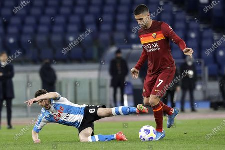 Napoli's Mario Rui, left, fights for the ball with Roma's Lorenzo Pellegrini during the Italian Serie A soccer match between Roma and Napoli at Rome's Olympic stadium