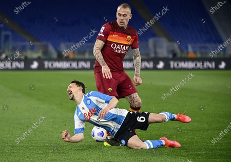 Roma's Rick Karsdorp (R) in action against Napoli's Mario Rui (L) during the Italian Serie A soccer match between AS Roma and SSC Napoli at the Olimpico stadium in Rome, Italy, 21 March 2021.