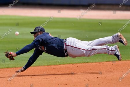 Atlanta Braves first baseman Pablo Sandoval makes a diving attempt for a ball hit for a single by Tampa Bay Rays' Brandon Lowe during a spring training baseball game, in Port Charlotte, Fla