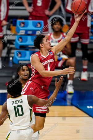Wisconsin guard Jonathan Davis (1) shoots over Baylor guard Adam Flagler (10) in the second half of a second-round game in the NCAA men's college basketball tournament at Hinkle Fieldhouse in Indianapolis