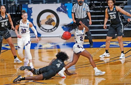 Northwestern guard Lauryn Satterwhite (2) is fouled by UCF guard Kiera Brown (4) during the first half of a college basketball game in the first round of the NCAA women's tournament at Greehey Arena in San Antonio