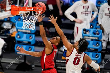 Texas Tech guard Terrence Shannon Jr. (1) shoots in front of Arkansas forward Justin Smith (0) in the first half of a second-round game in the NCAA men's college basketball tournament at Hinkle Fieldhouse in Indianapolis