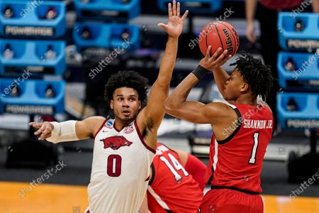 Texas Tech guard Terrence Shannon Jr. (1) shoots over Arkansas forward Justin Smith (0) in the first half of a second-round game in the NCAA men's college basketball tournament at Hinkle Fieldhouse in Indianapolis