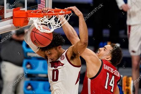 Stock Photo of Arkansas forward Justin Smith (0) gets a dunk in front of Texas Tech forward Marcus Santos-Silva (14) in the second half of a second-round game in the NCAA men's college basketball tournament at Hinkle Fieldhouse in Indianapolis