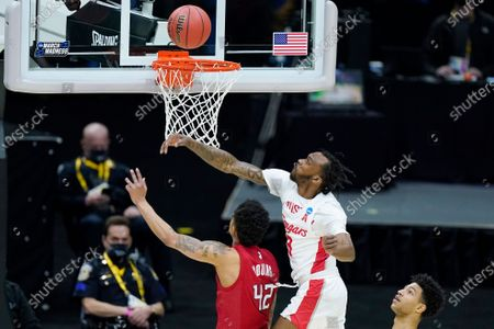 Houston's DeJon Jarreau (3) blocks a shot by Rutgers' Jacob Young (42) during the first half of a college basketball game in the second round of the NCAA tournament at Lucas Oil Stadium in Indianapolis