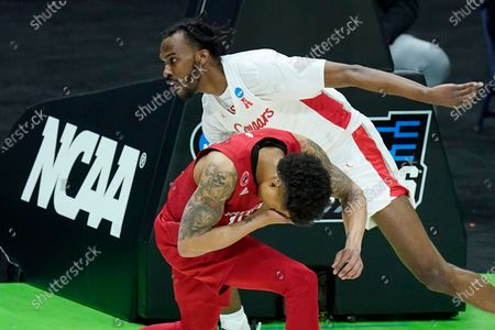 Rutgers' Jacob Young, bottom, covers his face after colliding with Houston's DeJon Jarreau, top, during the first half of a college basketball game in the second round of the NCAA tournament at Lucas Oil Stadium in Indianapolis