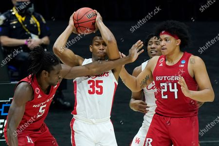 Stock Picture of Houston's Fabian White Jr. (35) protects the ball from Rutgers' Cliff Omoruyi (5) and Ron Harper Jr. (24) during the second half of a college basketball game in the second round of the NCAA tournament at Lucas Oil Stadium in Indianapolis