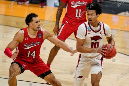 Texas Tech forward Marcus Santos-Silva (14) defends Arkansas forward Jaylin Williams (10) in the second half of a second-round game in the NCAA men's college basketball tournament at Hinkle Fieldhouse in Indianapolis