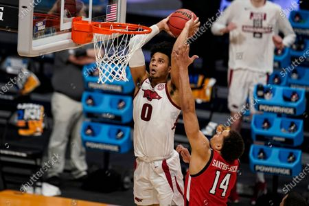 Stock Image of Arkansas forward Justin Smith (0) gets a dunk in front of Texas Tech forward Marcus Santos-Silva (14) in the second half of a second-round game in the NCAA men's college basketball tournament at Hinkle Fieldhouse in Indianapolis
