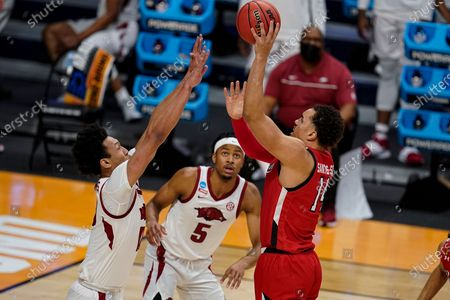 Texas Tech forward Marcus Santos-Silva (14) shoots over Arkansas forward Jaylin Williams (10) in the first half of a second-round game in the NCAA men's college basketball tournament at Hinkle Fieldhouse in Indianapolis
