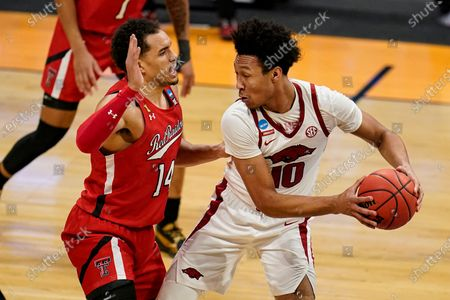 Stock Photo of Arkansas forward Brandon Kimble (14) defends Arkansas forward Jaylin Williams (10) in the second half of a second-round game in the NCAA men's college basketball tournament at Hinkle Fieldhouse in Indianapolis