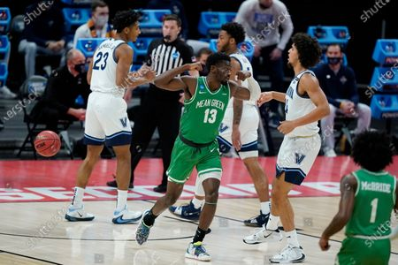 North Texas's Thomas Bell (13) reacts after scoring during the first half of a second-round game against Villanova in the NCAA men's college basketball tournament at Bankers Life Fieldhouse, in Indianapolis