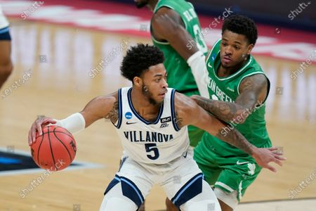 Villanova's Justin Moore (5) is defended by North Texas' Javion Hamlet (3) during the first half of a second-round game in the NCAA men's college basketball tournament at Bankers Life Fieldhouse, in Indianapolis