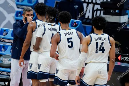 Stock Photo of Villanova head coach Jay Wright greets his players as they are taken out during the second half of a second-round game against North Texas in the NCAA men's college basketball tournament at Bankers Life Fieldhouse, in Indianapolis. Villanova won 84-61