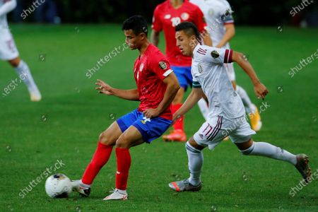 Ian Smith (L) of Costa Rica in action against Roberto Alvarado (R) of Mexico during the CONCACAF Men's Olympic Qualification tournament between Costa Rica and Mexico at the Akron Stadium, in Guadalajara, Jalisco, Mexico, 21 March 2021.