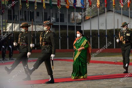 Nepalese Army personnel offer a guard of honor towards President Bidya Devi Bhandari before leave for two-day official state visit to Bangladesh on Monday, March 22, 2021 on invitation of her Bangladeshi counterpart Mohammad Abdul Hamid to attend the celebration of the birth centenary of Bangabandhu Sheikh Mujibur Rahman, the Father of the Nation of Bangladesh.