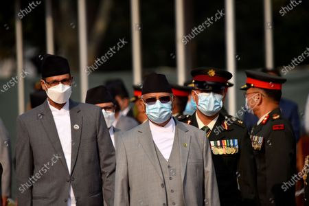 Stock Photo of Prime Minister KP Sharma Oli (R), Speaker Agni Sapkota (L) along with face mask arrive to farewell President Bidya Devi Bhandari for two-day official state visit to Bangladesh on Monday, March 22, 2021 on invitation of her Bangladeshi counterpart Mohammad Abdul Hamid to attend the celebration of the birth centenary of Bangabandhu Sheikh Mujibur Rahman, the Father of the Nation of Bangladesh.