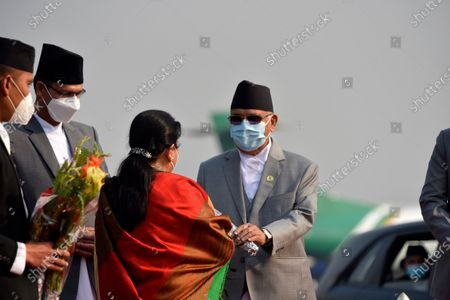 Prime Minister KP Sharma Oli along with face mask give flower bouquet to farewell President Bidya Devi Bhandari for two-day official state visit to Bangladesh on Monday, March 22, 2021 on invitation of her Bangladeshi counterpart Mohammad Abdul Hamid to attend the celebration of the birth centenary of Bangabandhu Sheikh Mujibur Rahman, the Father of the Nation of Bangladesh.