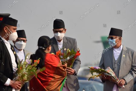Stock Picture of Speaker Agni Sapkota along with face mask give flower bouquet to farewell President Bidya Devi Bhandari for two-day official state visit to Bangladesh on Monday, March 22, 2021 on invitation of her Bangladeshi counterpart Mohammad Abdul Hamid to attend the celebration of the birth centenary of Bangabandhu Sheikh Mujibur Rahman, the Father of the Nation of Bangladesh.