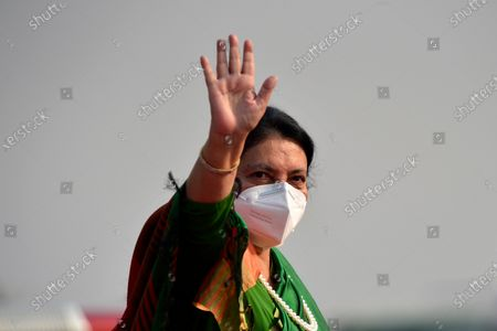 President Bidya Devi Bhandari along with face mask wave her hand before leave for two-day official state visit to Bangladesh on Monday, March 22, 2021 on invitation of her Bangladeshi counterpart Mohammad Abdul Hamid to attend the celebration of the birth centenary of Bangabandhu Sheikh Mujibur Rahman, the Father of the Nation of Bangladesh.