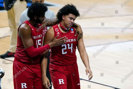 Rutgers' Myles Johnson (15) and Ron Harper Jr. (24) leave the court following their loss to Houston in a college basketball game in the second round of the NCAA tournament at Lucas Oil Stadium in Indianapolis . Houston won 63-60