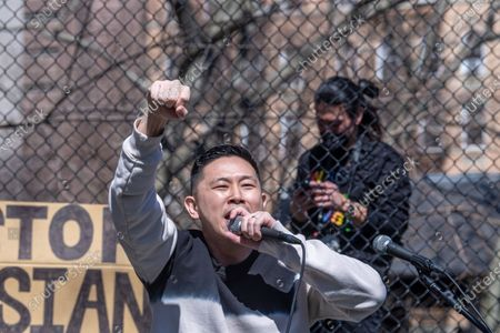 Stock Photo of Jin Au-Yeung, MC Jin, performs during a rally against hate in Columbus Park in the Chinatown neighbourhood of Manhattan in New York City. A rally for solidarity was organized in response to a rise in hate crimes against the Asian community since the start of the coronavirus (COVID-19) pandemic in 2020. On March 16 in Atlanta, Georgia, a man went on a shooting spree in three spas that left eight people dead, including six Asian women.