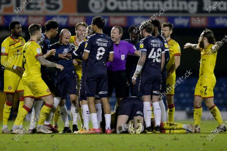 Southend United players clash with Walsall after Sam Hart of Southend United fouls Derick Osei of Walsall  during Sky Bet League Two match between Southend United and Walsall at Roots Hall in Southend - 23rd March 2021