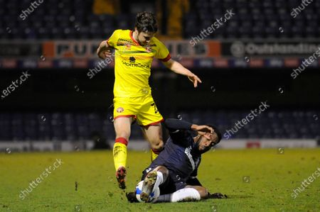 Stock Photo of Nathan Ferguson of Southend United and Frank Vincent of Walsall in action during Sky Bet League Two match between Southend United and Walsall at Roots Hall in Southend - 23rd March 2021