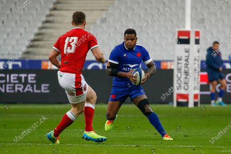 France's wing Virimi Vakatawa, with the ball, faces Wales' George North during the Six Nations rugby union match between France and Wales at the Stade de France in Sain-Denis, outside Paris