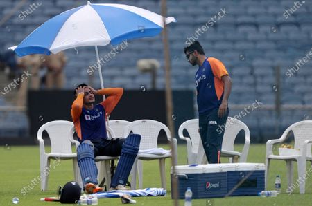 Indian players Shubman Gill, left, and Shardul Thakur chat during a training session ahead of their first one day international cricket match against England in Pune, India