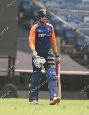 Stock Photo of Indian player Shubman Gill walks during a training session ahead of their first one day international cricket match against England in Pune, India
