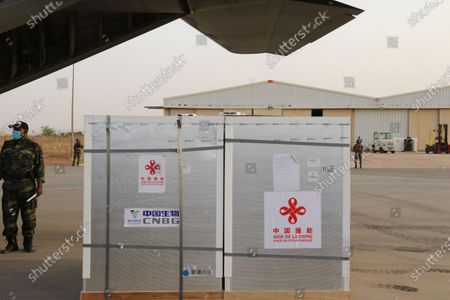 Stock Image of Boxes containing COVID-19 vaccines from China are seen at the Niamey International Airport in Niamey, Niger, on March 21, 2021. President of Niger Mahamadou Issoufou, Prime Minister of Niger Brigi Rafini, Niger's acting Health Minister Ahmed Boto and Chinese Ambassador to Niger Zhang Lijun attended the handover ceremony at the airport on Sunday.