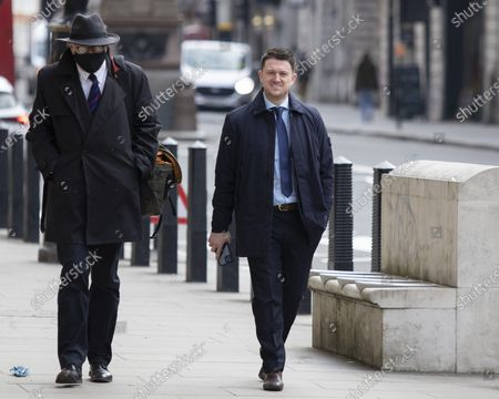 """Stock Image of Tommy Robinson arrives at the Royal Courts of Justice for a preliminary hearing in a libel case brought against him by Jamal Hijazi. The EDL founder commented on a video of Jamal Hijazi being attacked in a school and claimed that """"he was not innocent and he violently attacks young English girls in his school""""."""