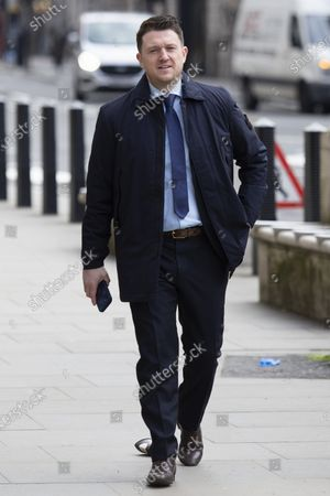 """Tommy Robinson arrives at the Royal Courts of Justice for a preliminary hearing in a libel case brought against him by Jamal Hijazi. The EDL founder commented on a video of Jamal Hijazi being attacked in a school and claimed that """"he was not innocent and he violently attacks young English girls in his school""""."""