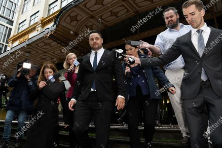 Jarryd Hayne (C) leaves Downing Centre District Court after a day of his trial in Sydney, Australia, 22 March 2021. Former NRL rugby player Jarryd Hayne has been found guilty of sexual assault during a retrial.