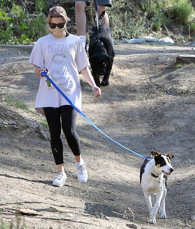 Stock Photo of Ava Elizabeth Phillippe wakling the dogs while hiking