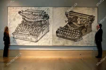 Members of staff poses with 'Large Typewriters', by South African artist William Kentridge, estimated at GBP350,000-550,000,